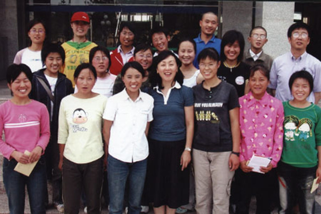 Ching surrounded by students