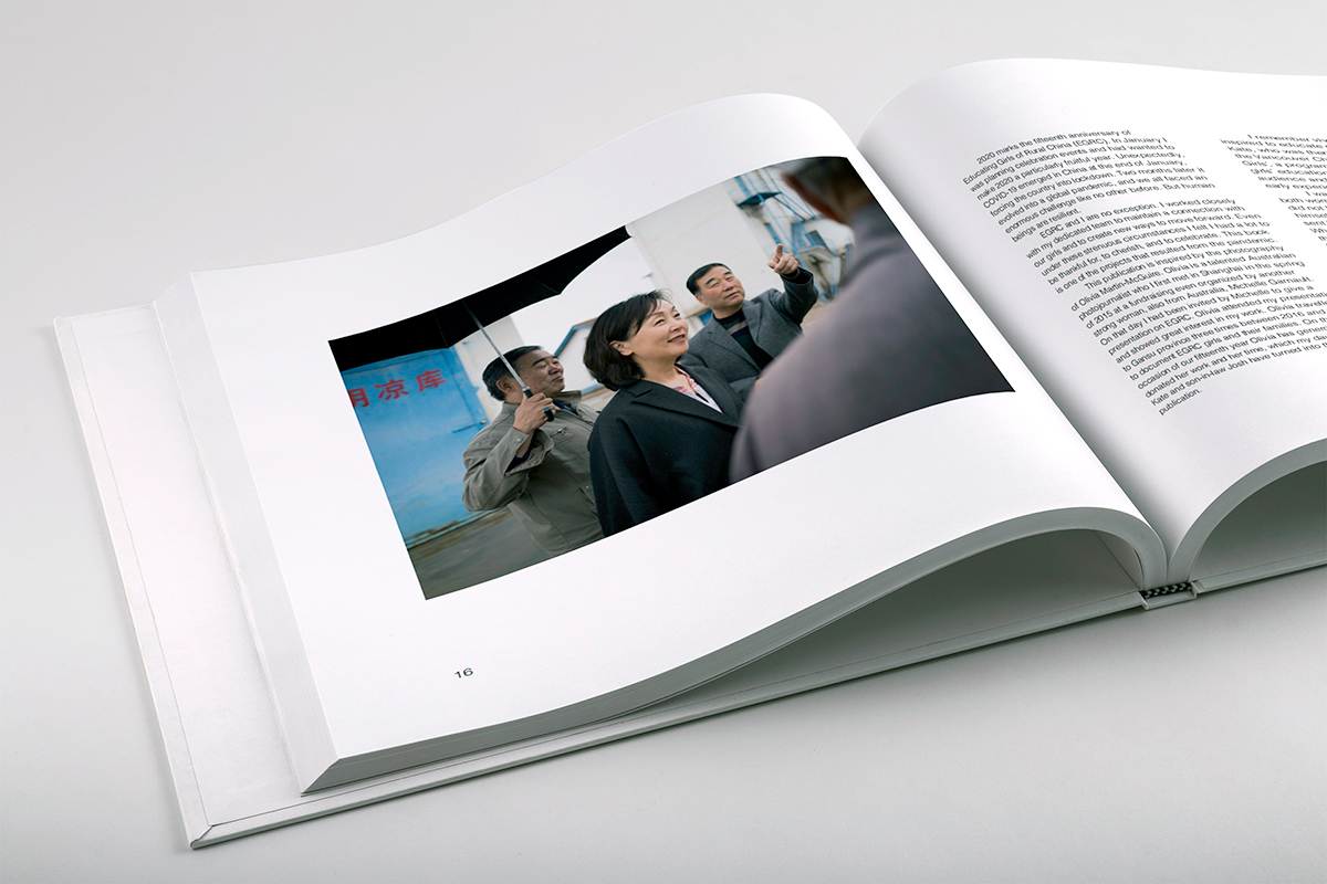 White inside pages featuring EGRC Founder Ching Tien