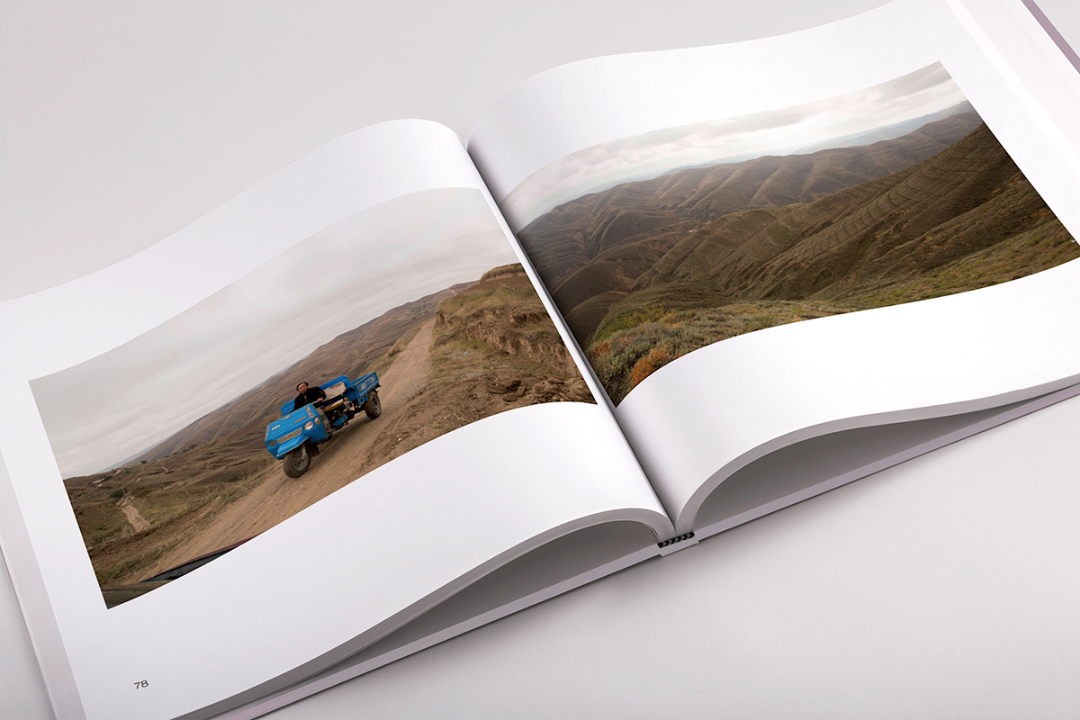 White inside pages with rural China landscape images